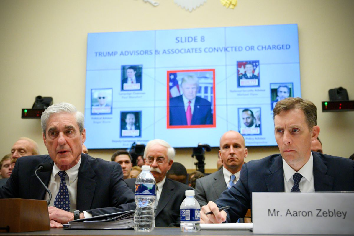 Former Special Counsel Robert Mueller testifies before the House Select Committee on Intelligence hearing next to Former Deputy Special Counsel Aaron Zebley (left) on July 24, 2019.