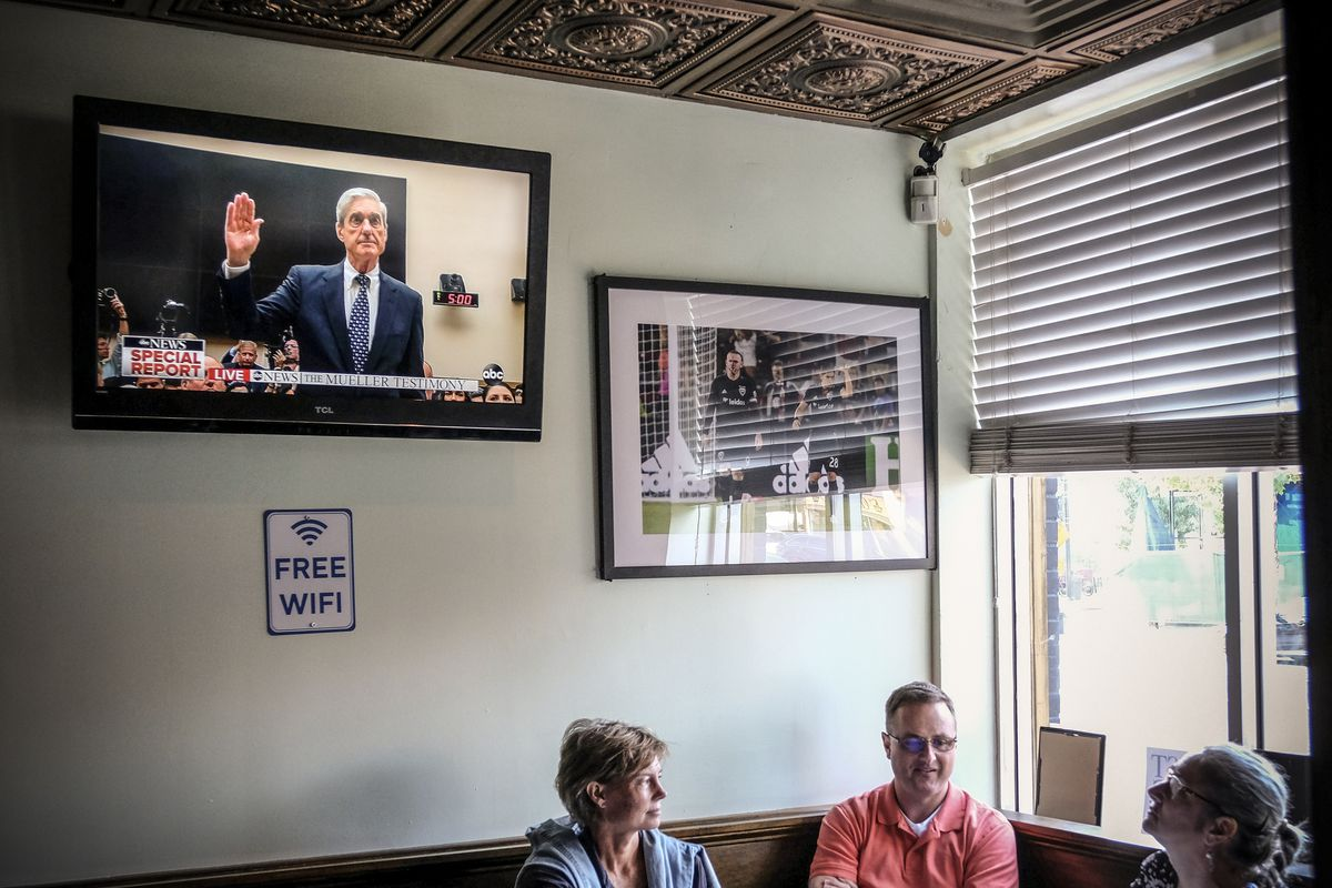 Customers inside Duffy's Irish Pub watch the live broadcast of former Special Counsel Robert Mueller's testimony on July 24, 2019.