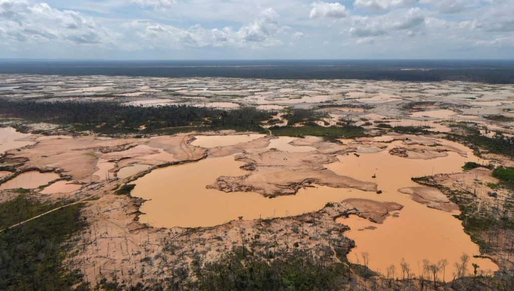 This chemically deforested area of the Amazon jungle was caused by illegal mining activities in the river basin of the Madre de Dios region in southeast Peru. Illegal mining has destroyed more than 11,000 hectares of Amazon rainforest.