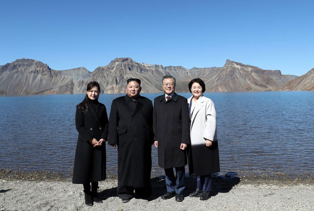 Kim, Moon, and their wives on top of Mount Paektu.