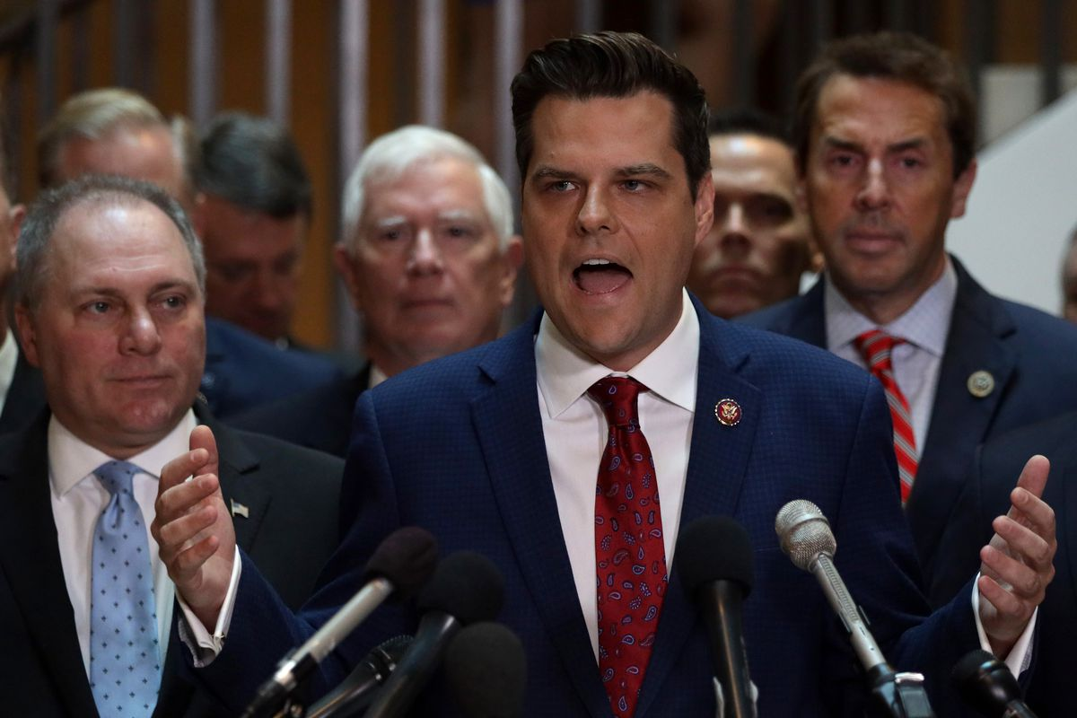 Flanked by about two dozen fellow House Republicans, Matt Gaetz speaks to reporters as House Minority Whip Steve Scalise listens.