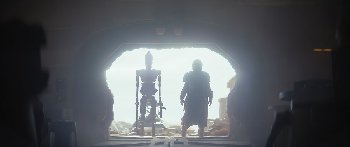 The Mandalorian and a droid track down a bounty.