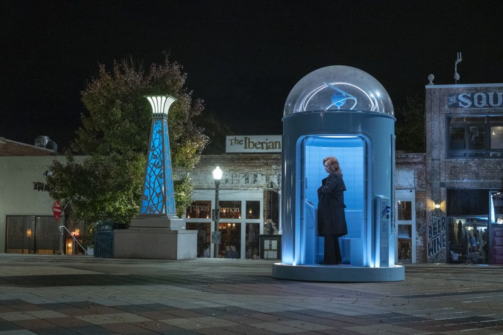 Phone booths allow humans to make petitions of Doctor Manhattan.