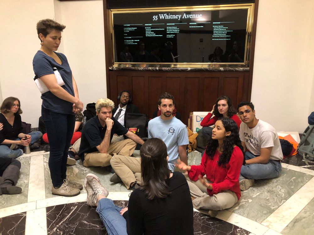 Divestment campaigners at Yale University stage a sit-in at the school's investments office on April 2, 2019.