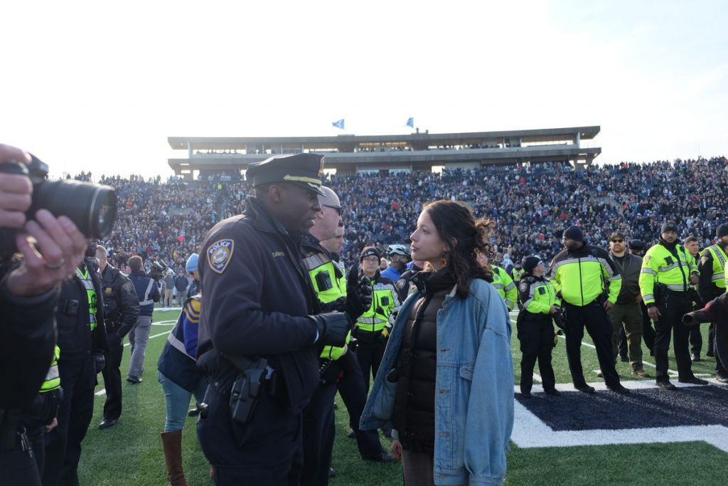 A student protestor speaks to police at the Harvard and Yale football game on November 23, 2019.