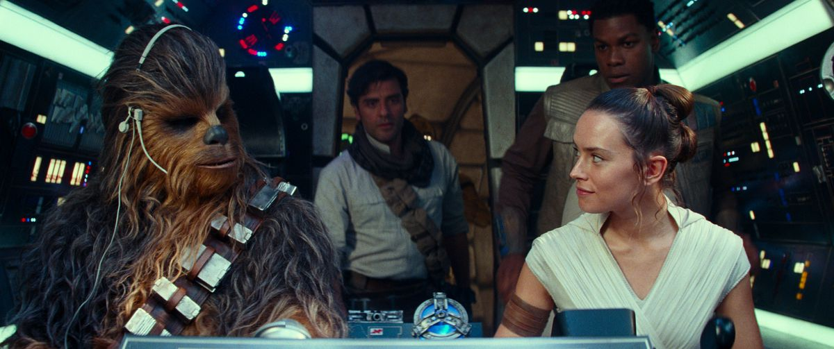 Chewy, Rey, Finn, and Poe prepare to take off in the Millennium Falcon.