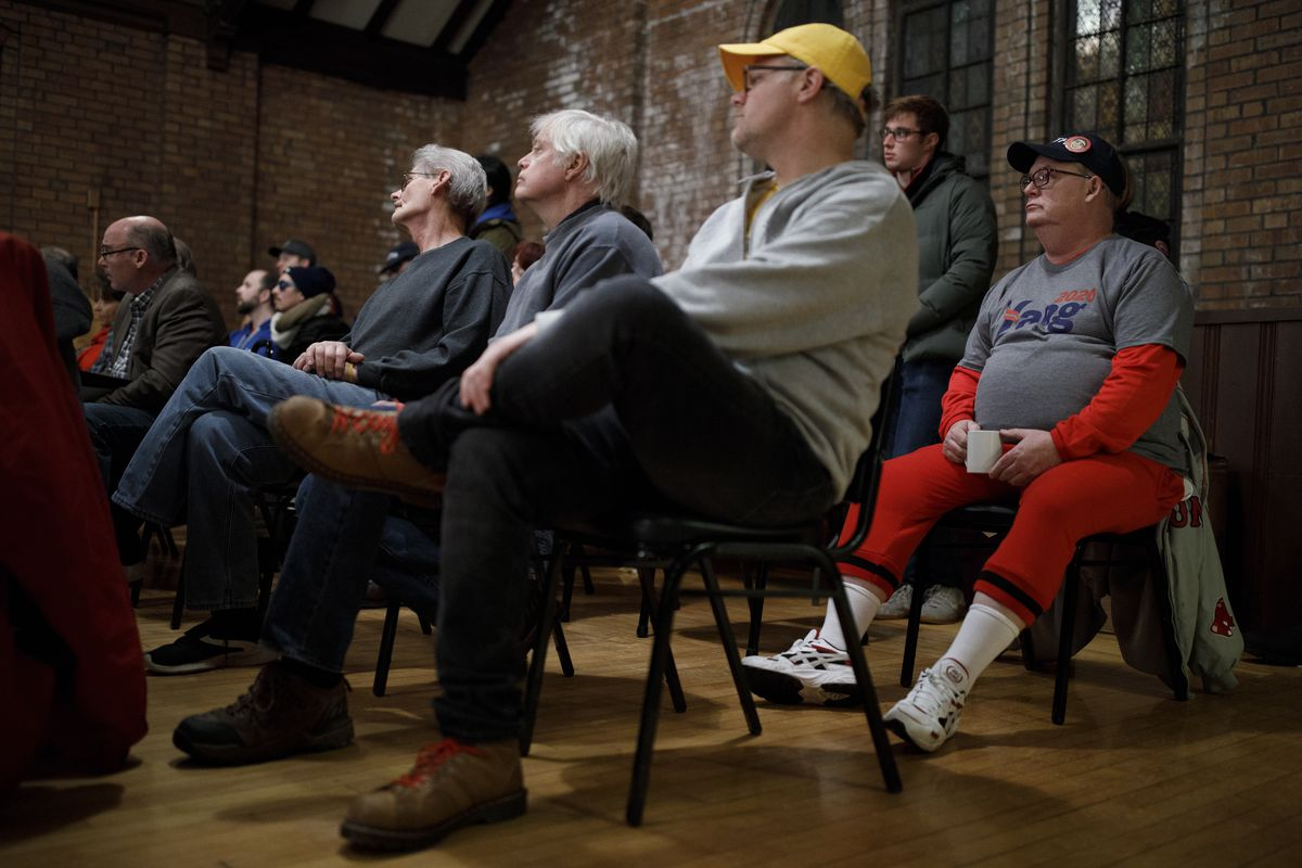 Members of the audience listen to event organizers during the start of a mock caucus event on January 28, 2020 in Mason City, Iowa.