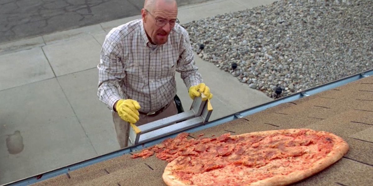 "Walter White climbs a ladder to fetch a pizza off a house roof in ""Breaking Bad."""