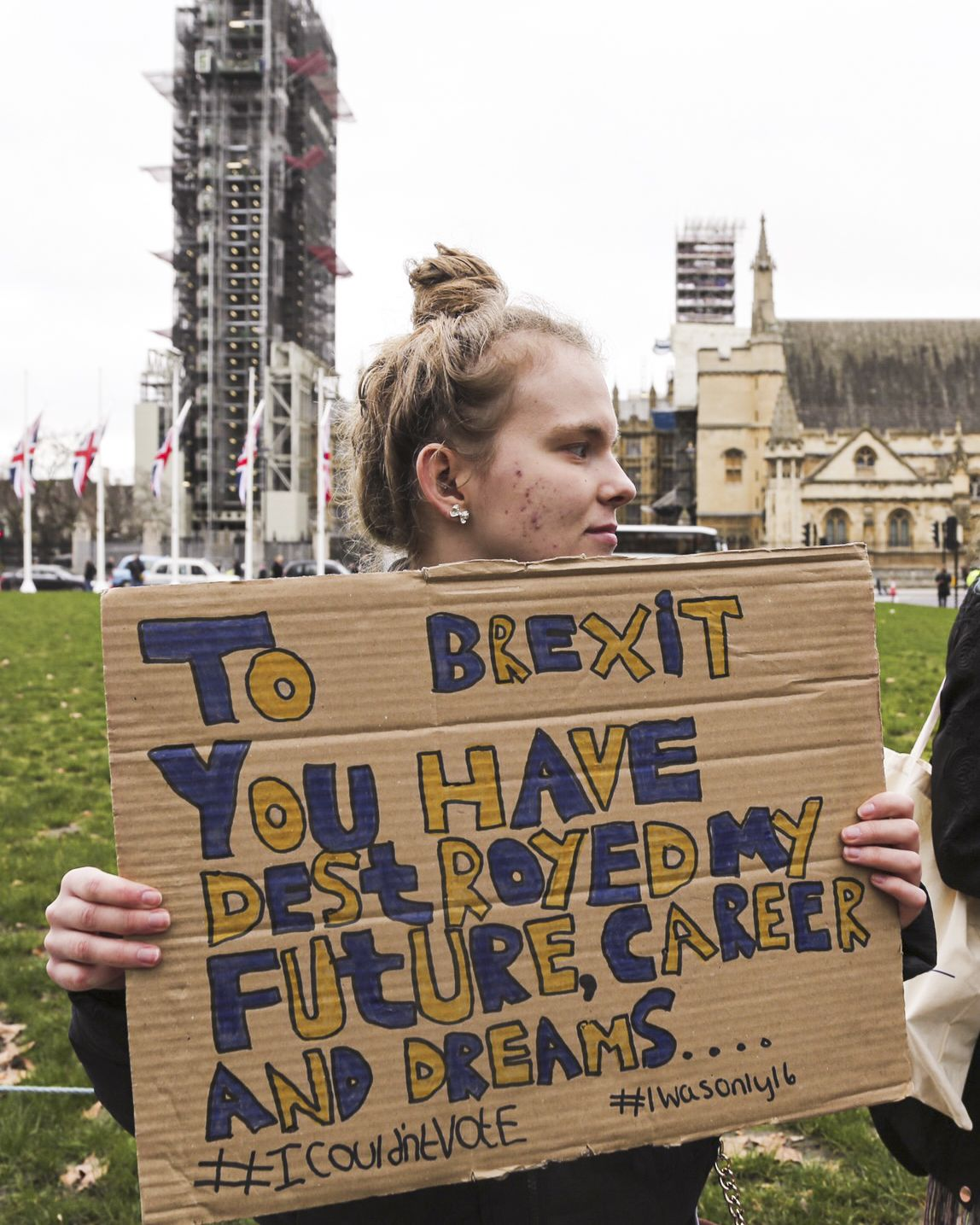 "A person holding a sign saying ""To Brexit you have destroyed my future, career and dreams"""