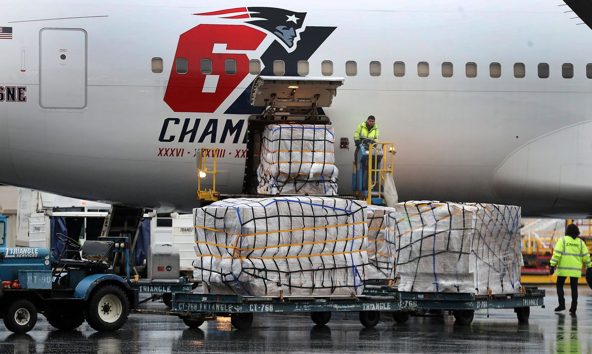 A New England Patriots jet arrives at Logan Airport in East Boston on Apr. 1, 2020 after flying from China with a massive shipment of over one million N95 masks which will be used in Boston and New York to help fight the spread of the coronavirus.