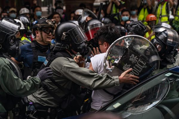 Hong Kong demonstrators defy lockdowns to protest a sweeping new national security law