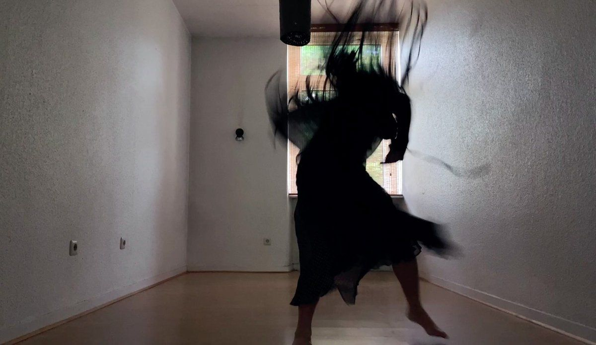 A dancer flails so fast that the image is blurry.