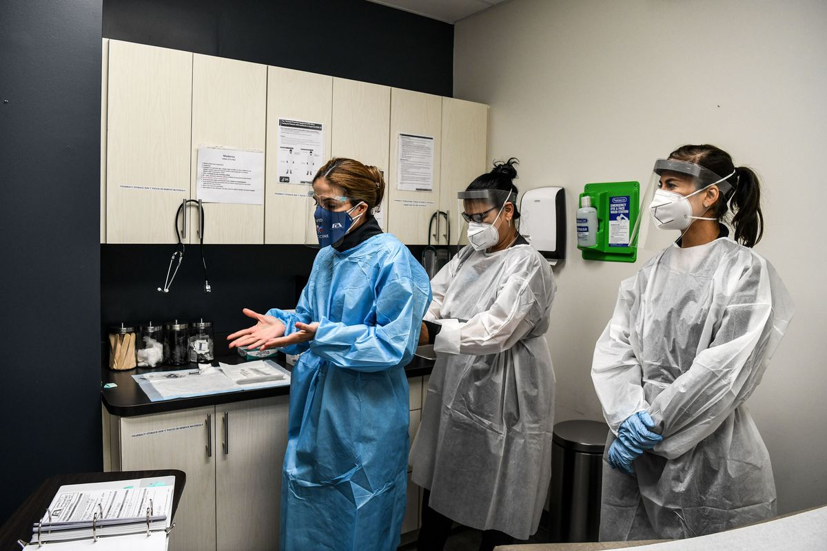 Workers prepare for medical examination of a volunteer for the COVID-19 vaccine study at the Research Centers of America (RCA) in Hollywood, Florida, on August 13, 2020.