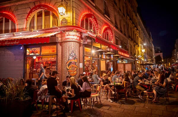 A bar in Paris on Sunday. Deaths from the coronavirus in France, about 30 people a day, have reduced markedly from the peak, when hundreds and sometimes more than 1,000 died daily.