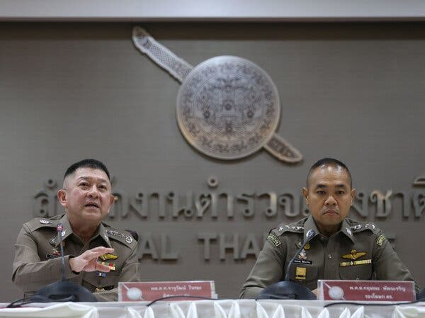 Col. Kissana Phathanacharoen, right, deputy spokesman for the Royal Thai Police, at a news conference last month announcing that Thailand had reopened the case against Mr. Vorayuth.
