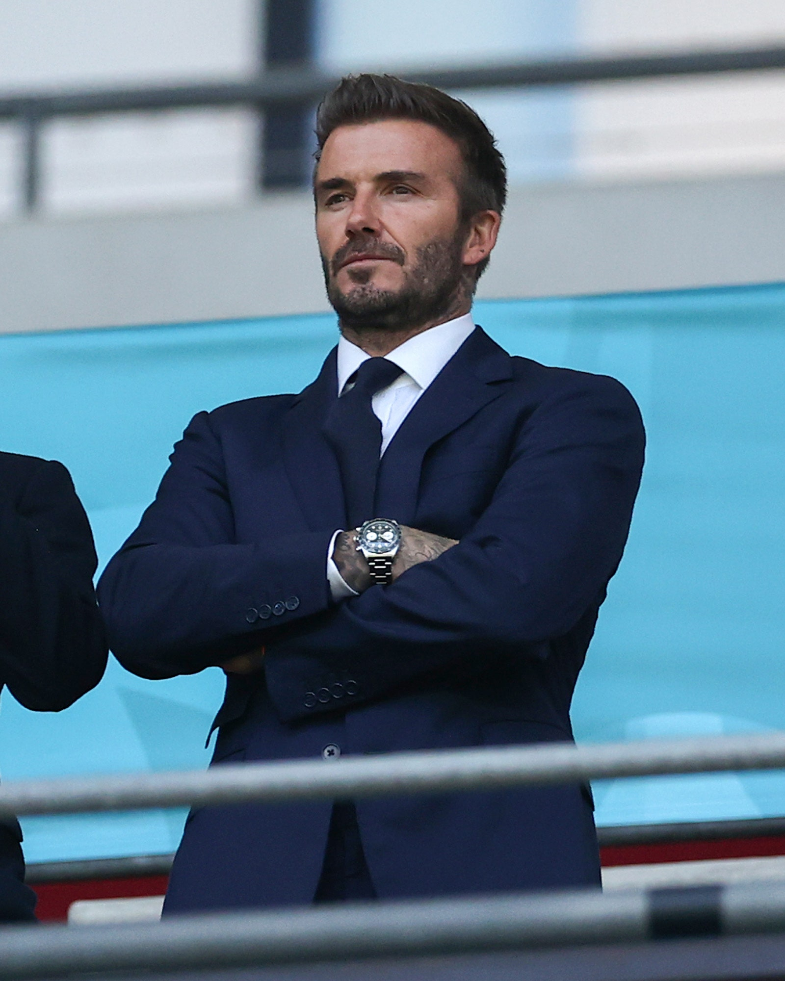 Romeo Beckham and David Beckham Former England International react as they watch on from the stands during the UEFA Euro...