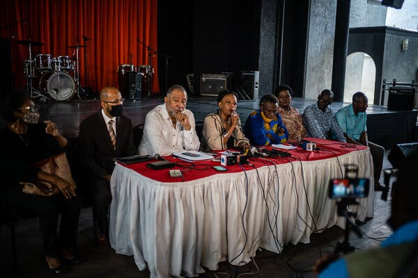 """Magali Comeau-Denis, center, on Tuesday with a group called """"The Commission,"""" which represents more than 100 civil society organizations in Haiti."""
